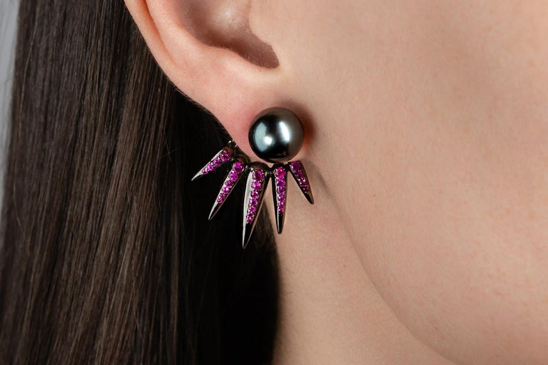 These Exquisite Jacket Earrings designed by Nikos Koulis and his characteristic Spectrum collection feature 1,25 carats of rubies, black pearl & black rhodium. Can be worn as a set or with several combinations composing a fascinating pair of