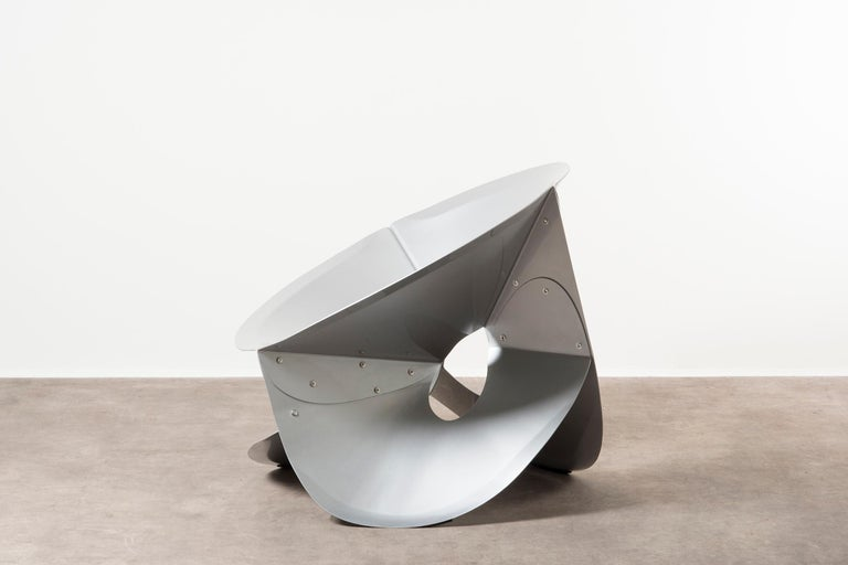 Chair Swirl by Michael Schoner, the Netherlands, 2019. Nilufar edition. Aluminum, power-coated. Measures: 90 x 84 x H 76 cm, 35.4 x 33 x H 30 in. The metal movements of Michael Schoner's objects are extreme experiments on the theme of seating. They