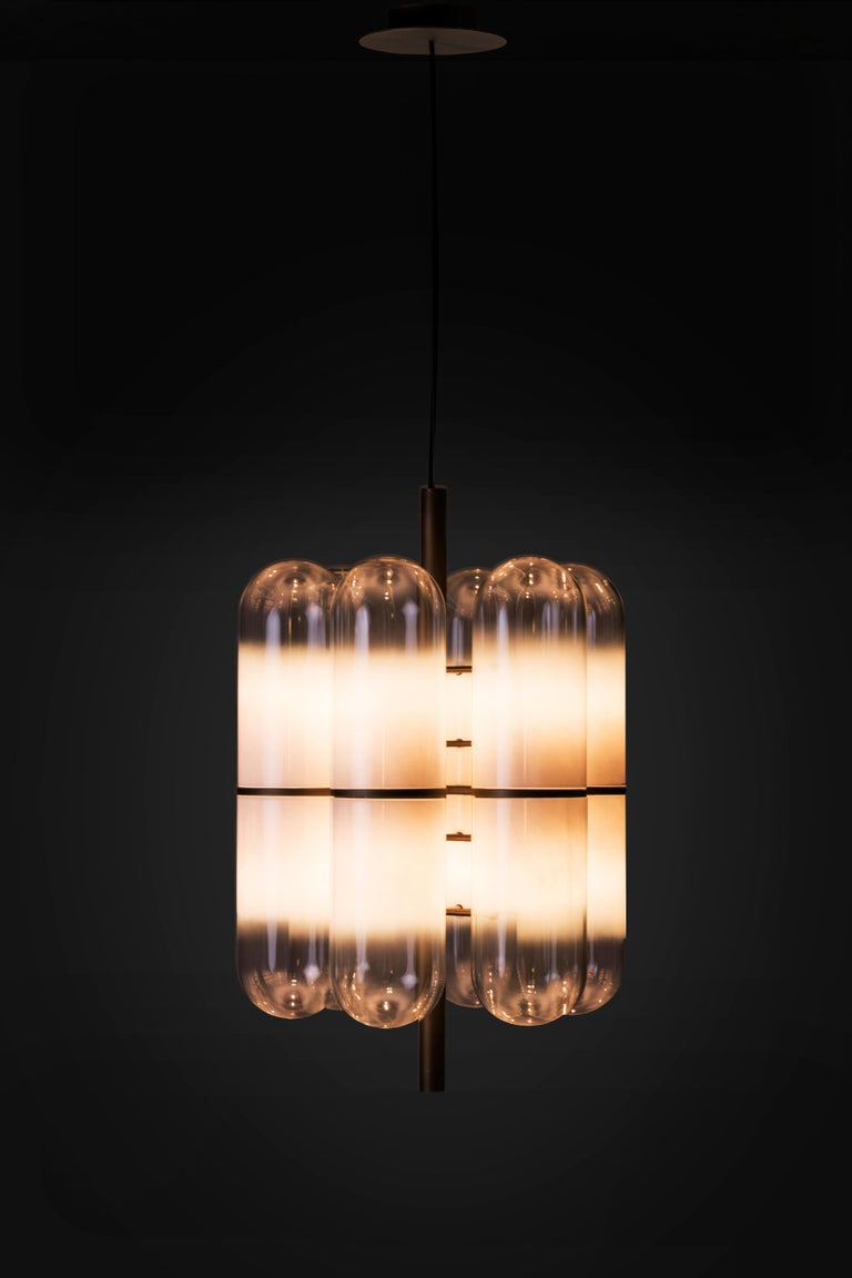 Charlotte M ceiling lamp by Federico Peri, Italy, 2018. Nilufar edition. Customizable upon request with different finishes. Burnished brass, borosilicate glass - 12 cloches. 52 x 52 x H 80 cm, 0.5 x 20.5 x 31.5 in. Suspended lamp made by hand blown