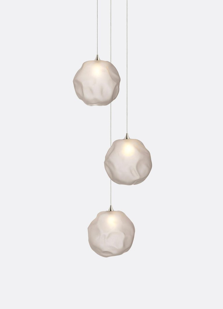 Hand blown glass pendants fixtures. 3 glass pendants on 8