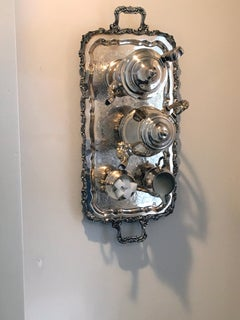 Entitled 100, Wall Sculpture featuring silver tray, Silver Teapot, Sugar, Cream