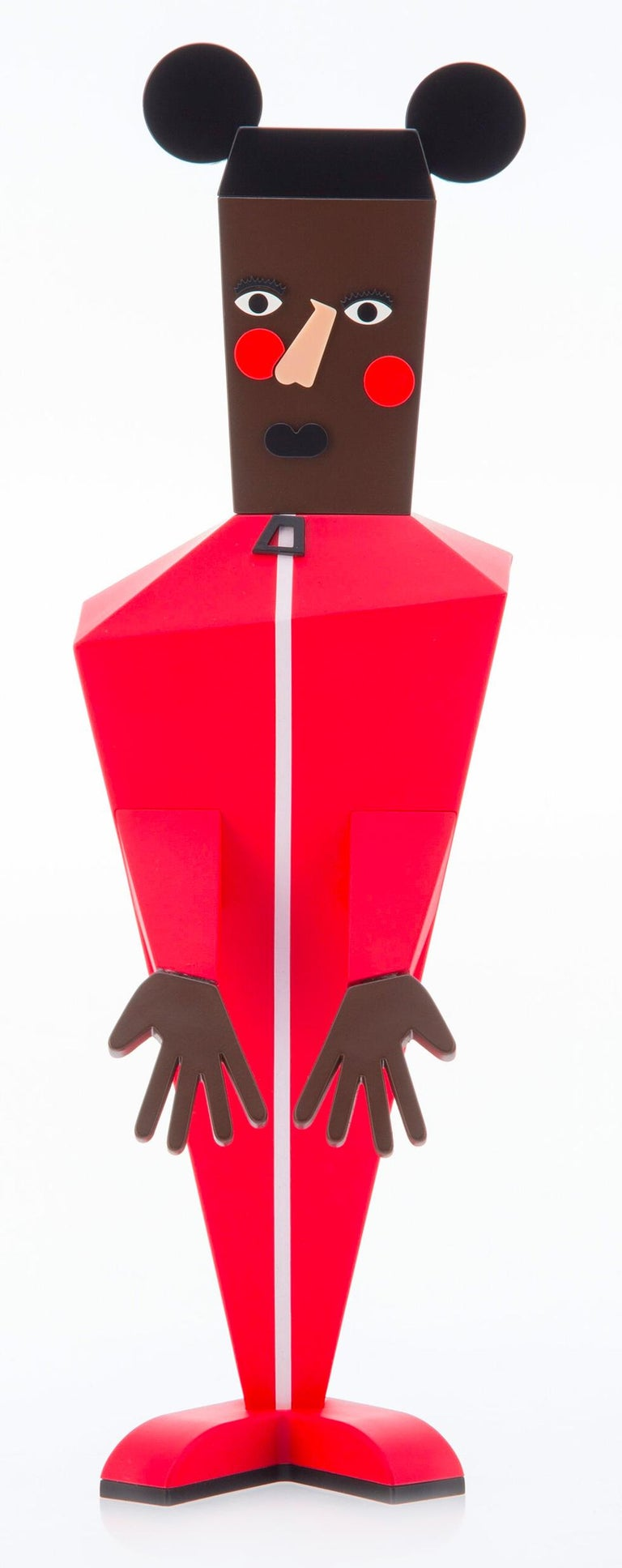 Nina Chanel Abney Baby:  Nina Chanel's 'Baby' figure strikingly re-imagines Mickey Mouse as a man dressed in a bright red jumpsuit, with mirroring red circles stamped on the cheeks. Constructed with sharp angles and an asymmetrical mold, the figure
