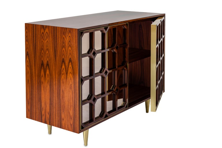 This credenza is inspired in Oriental antique screens and harmoniously combines natural wood, metal and bronze mirrors to create an impressive and sophisticated design, with its far inspirations and contemporary lines. The piece shows a strong