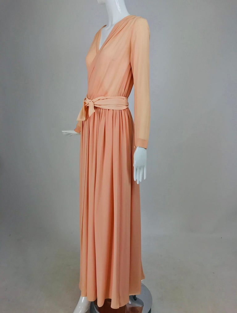 Nina Ricci Haute Boutique demi couture Peach Silk crepe Draped Bodice Evening Gown from the 1980s. This gorgeous gown is designed for someone tall with a longer waist. The gown has a suplice bodice, the cross drape is a classic design all the way