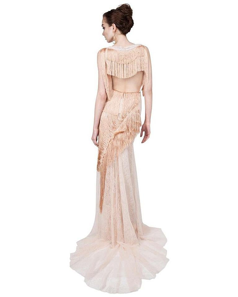 A rare Nina Ricci creation from the romantic Spring 2013 runway collection.  Featuring  romantic couture touches combined with a lighthearted spirit.  Peachy pink colorway boasts swags of decorative silk fringe arranged asymmetrically onto delicate