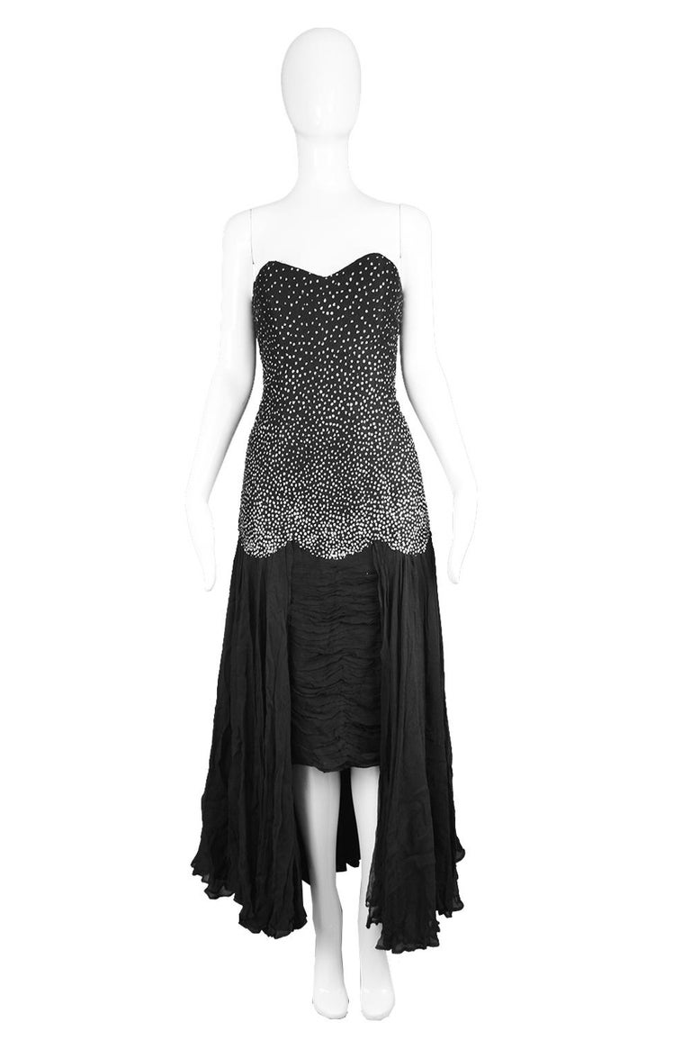 Nina Ricci Vintage Black Silk Chiffon & Silver Glitter Strapless Dress, 1980s  A breathtaking vintage women's evening gown from c. the late 80s by luxury French fashion house, Nina Ricci Paris. In a Black lace / tulle with a silver glitter effect