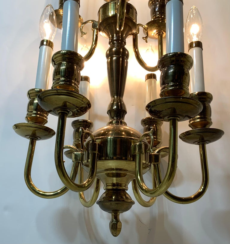 Elegant hanging chandelier made of solid brass with scrolled Ares, nine-light 60/watt each electrified and ready to use. Original canopy included.