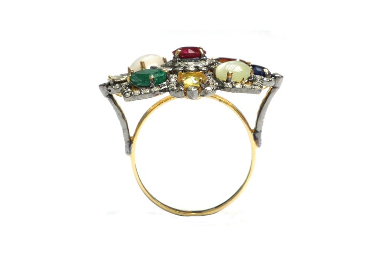 Nine Precious Gems Fashion Ring in Art-Deco Style  This immaculate Victorian period style Navratan (nine) gems ring is mesmerizing. Navratnas of the nine gemstones represent the nine planets on which Indian astrology is based and wearing them