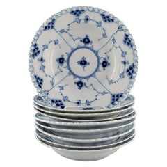 Nine Royal Copenhagen Blue Fluted Full Lace Deep Plates, Model Number 1/1070