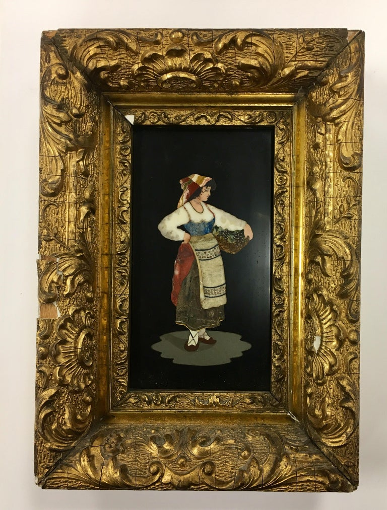 This is a rare 19th century German micromosaic plaque of onyx, and coral pieces. It is displayed within a heavily carved gilt frame. Micromosaics were popular purchases by visitors, easily portable, and often taken home to set into an object at
