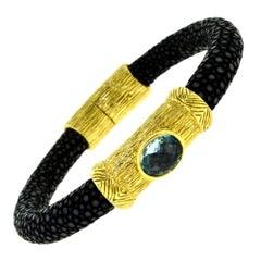 NINI Jewels Black Snake Finish Yellow Gold Bracelet with Blue Topaz Center Stone