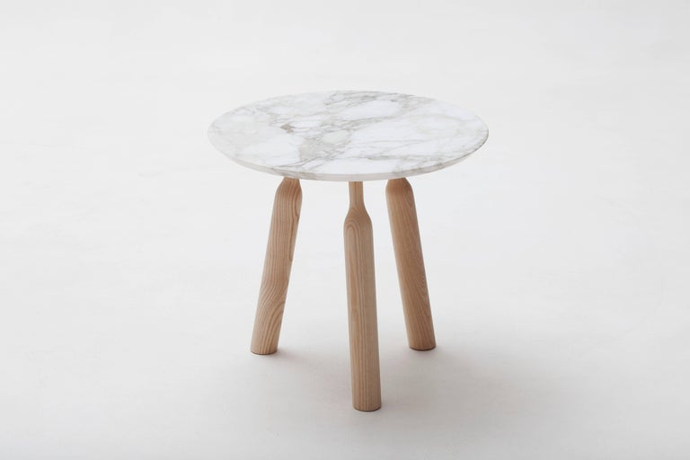 The ultra-chic Ninna side table was designed by Carlo Contin for luxury French furniture brand, Adentro Paris. The Ninna three legs base supports a thin-brushed marble top (marble can be (white) Calataca oro or (dark brown) Emperador. Its structure