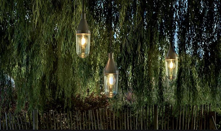 Niwa outdoor lamp by Christophe Pillet for Oluce. The light bulb is protected in a transparent blown-glass diffuser connected to a lacquered aluminum cone. 1 x max 15 W - E26 (LED) as lamp type.   Dimensions: 10cm W x 30cm L (1000cm cable length).