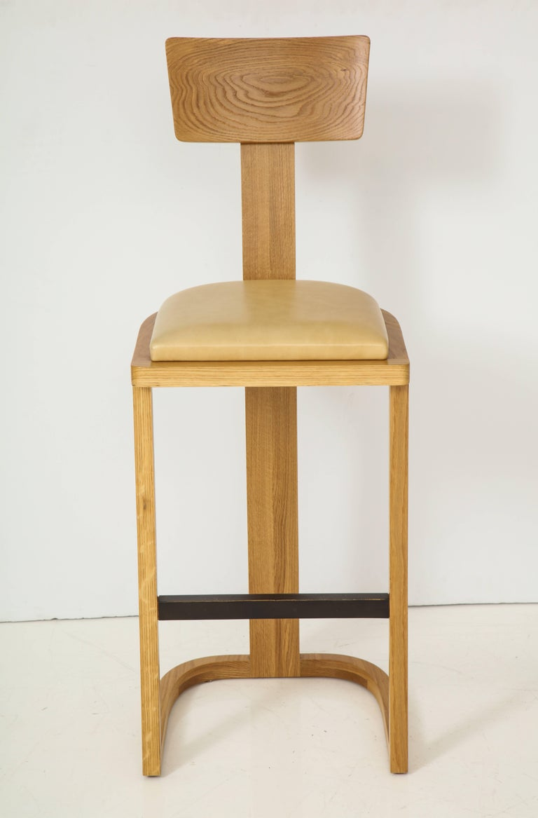 Solid oakwood barstool with U-shaped base and a slightly pitched, T-shaped backrest. Made in Los Angeles.