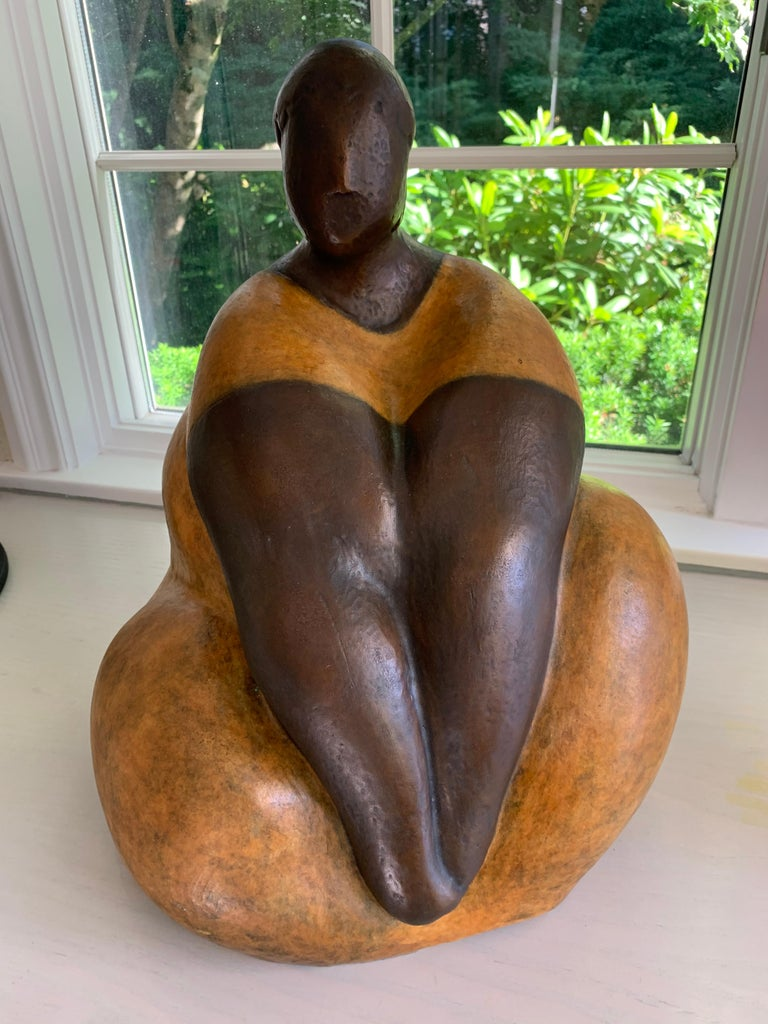 Nnamdi Okowkwo's stylized seated woman in an attitude of tranquility. To create it, he first sculpts the figure in clay, then casts it in bronze using thelost waxtechnique. A hot patina is applied using compounds that are specifically formulated