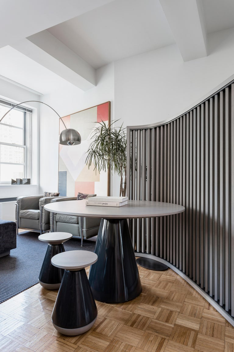 The No.1 Screen is part of a collection of furnishings pieces originally designed for a private residence in Manhattan.   The architecture and construction of the piece resembles a modernist building that stands itself by the boomerang foot print