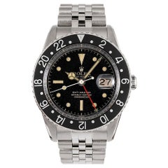 """Pre-Owned """"No Guard"""" Gilt Dial Rolex GMT Ref. #6542 with Roulette Date"""
