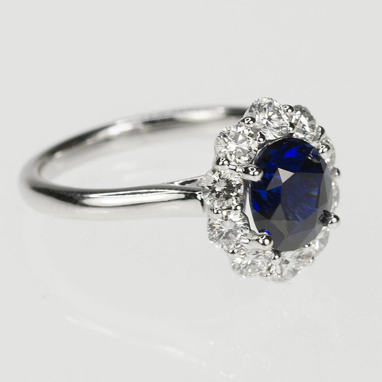 18k white gold ring with certified one 2.05 carat no heat sapphire and 10 round diamonds weighing 0.89 carat.