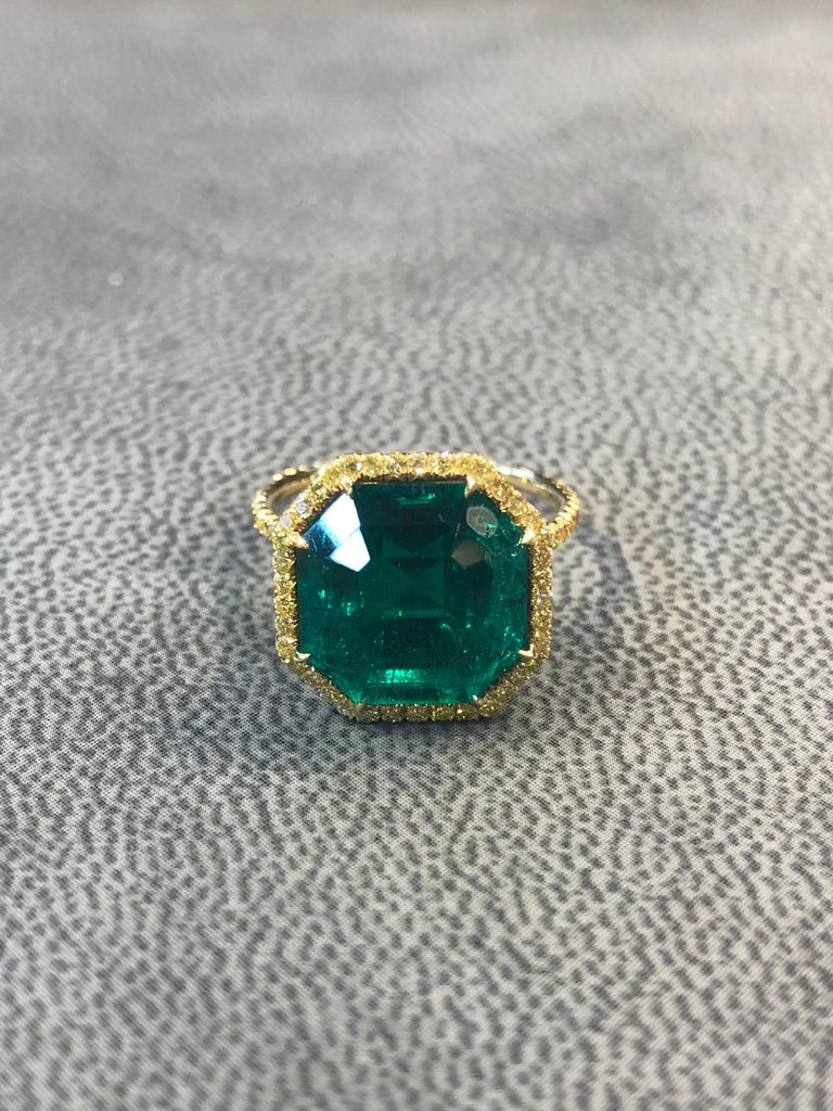 No Oil Emerald And Diamond Ring  emerald Weight : 6.84 carats Set with fancy yellow diamonds accompanied with AGL and SSEF Certificates stating the emerald is natural, Colombian with no treatment Size: 6 Sizable to any ring size