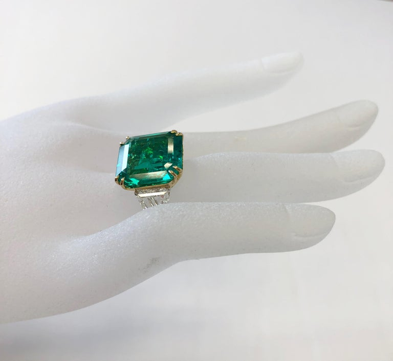 Gorgeous 10.07 carat Colombian emerald square emerald cut with no oil with 2.48 carats of good quality white diamond shield cut stones (1.11 ct G VS1 and 1.37 ct H VS1).  Handmade mounting in 18k two tone gold with AGL lab report.  Size 6.25.  This