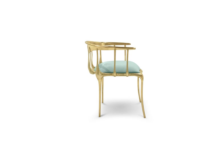The Nº11 armchair takes the cue from key figures of the surrealist movement such as Salvador Dali and René Magritte and turns their work into a subtle art furniture piece.  Made from gold plated solid cast brass with a varnish finish, this accent