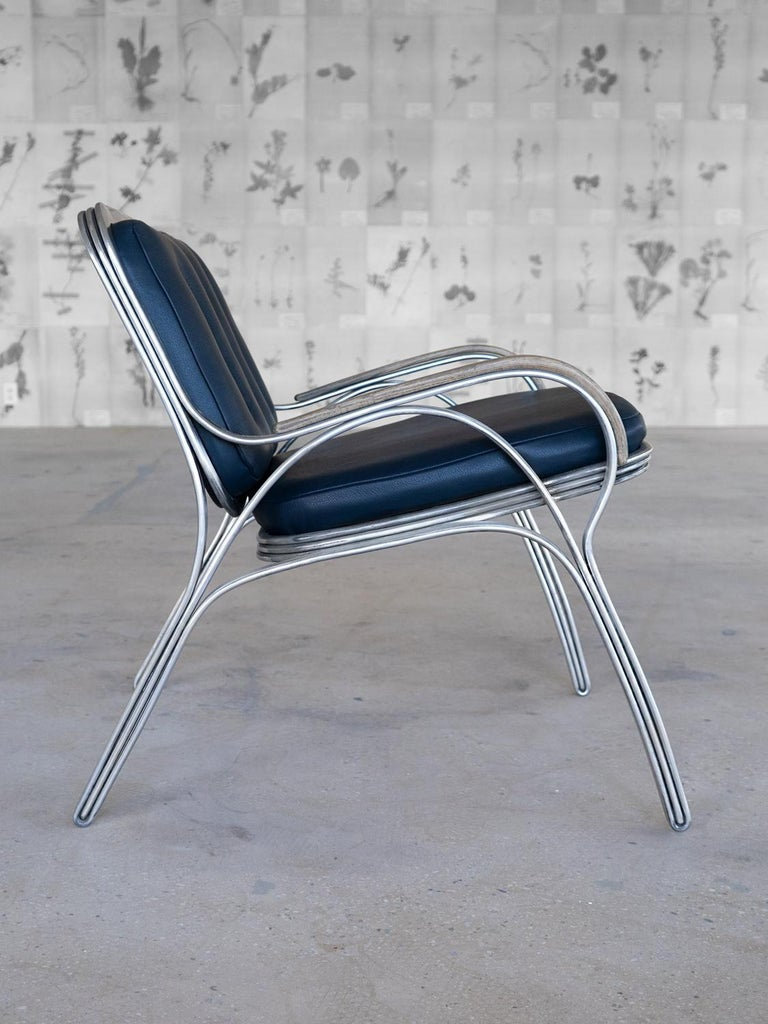 American Nº117 Lounge Seat by Avoirdupois - A metal, leather and bentwood lounge chair For Sale