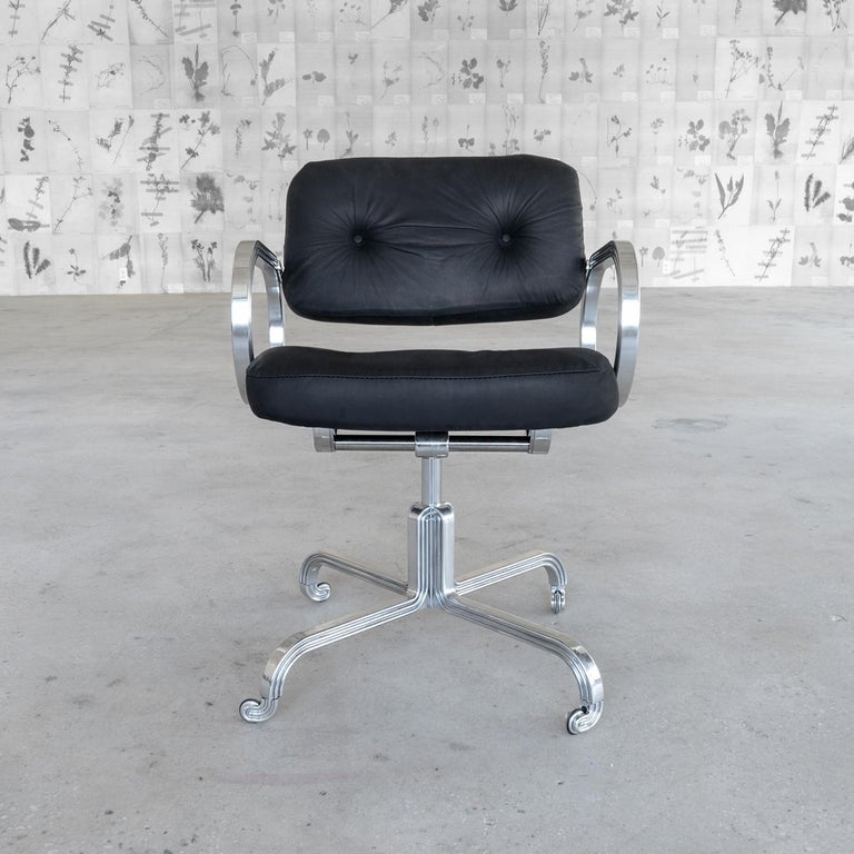 Manufactured in Manhattan, the Nº129 Profession Chair is composed of four aluminum legs bending sharply into one another to create a vertical repeating motif leading to a custom mechanism for tilt and swivel. The casters complete the triplicating