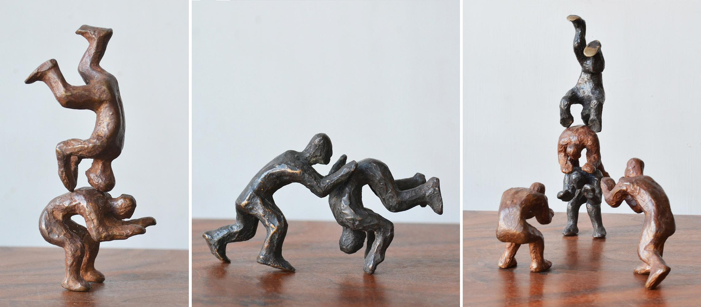 Why Fight When You Can Play? 2 Pairs of interactive miniature bronze figures