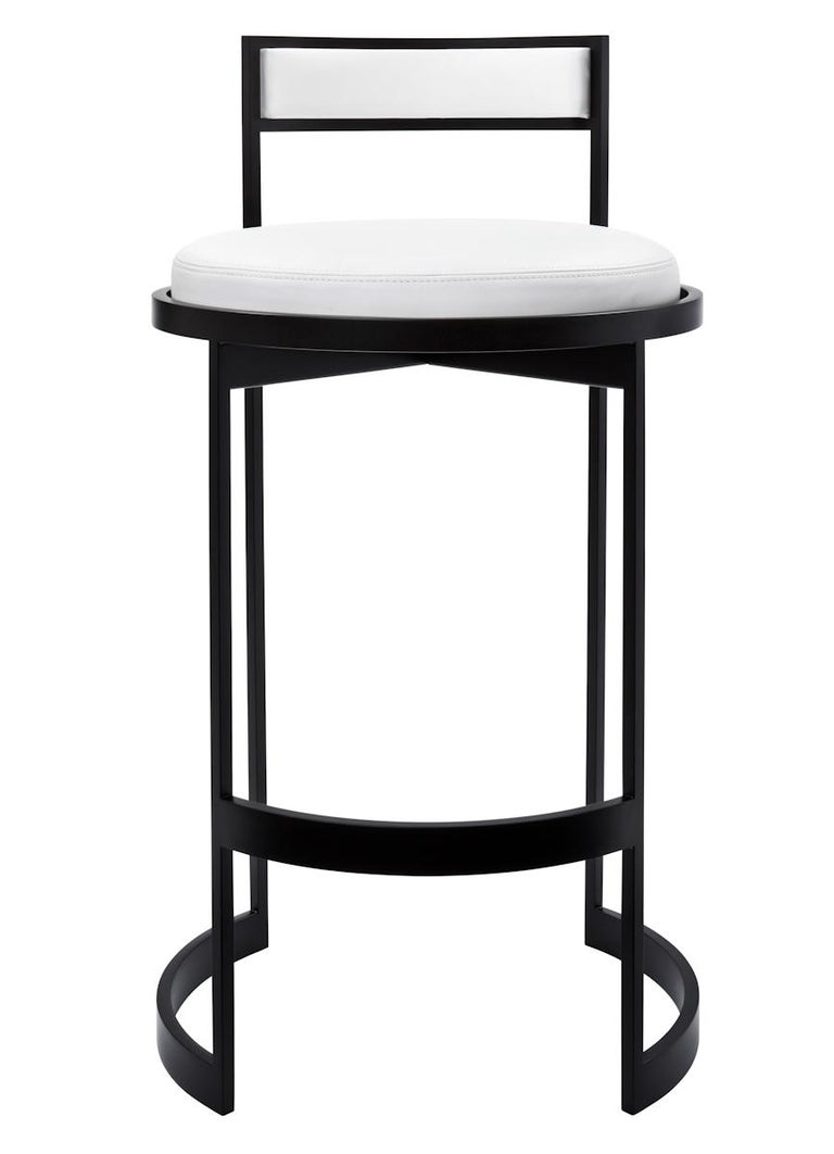 Contemporary bar stool with plated or powder coat steel frame and stationary cushioned backrest. Tightly upholstered swivel seat with top-stitched seams. Measures: Seat height 29