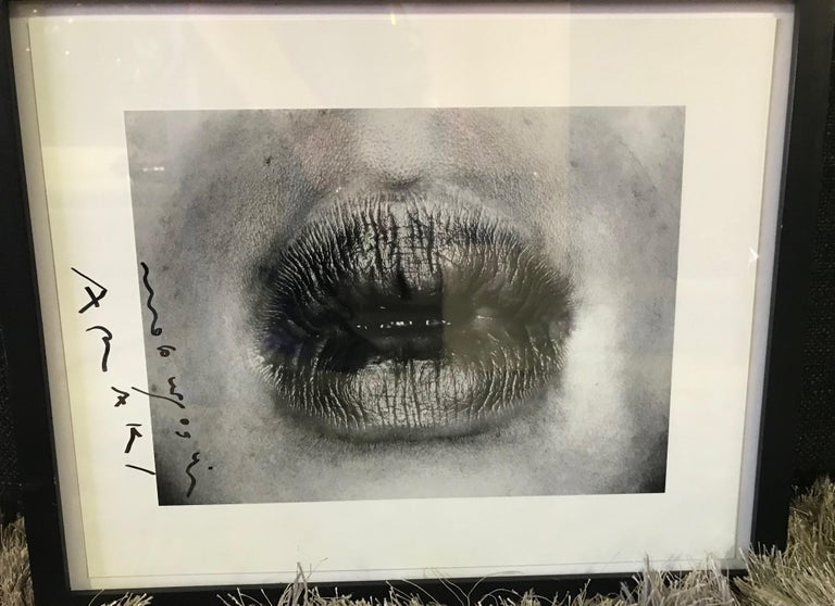A very engaging and alluring work by famed Japanese photographer and contemporary artist Nobuyoshi Araki from his 1993 highly sexually charged Erotos series.   The print is hand-signed in marker in the margin by Araki.  Would be a great addition