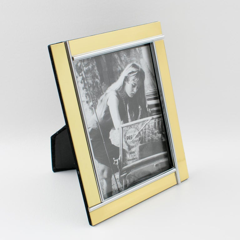 Elegant 1970s picture photo frames attributed to Noel B. C., Italy. Gilt brass and chrome geometric design with kinetic effect. Easel and back in black velvet. Picture photo frame can be placed in portrait or in landscape