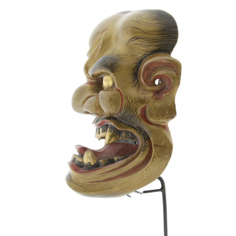 Kijin'kei - noh mask of a fierce god   Date: 19th century Size: 21.5 x 18 cm  Before Buddhism was introduced to Japan over six centuries ago, Shinto was the main system of belief focused on ritual practice. On New Years Eve, it was believed