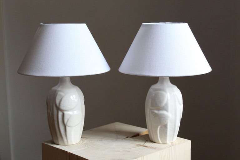 A pair of small table lamps produced by Søholm Keramik, located on the island of Bornholm in Denmark. Design by Noomi Backhausen. Marked and labeled. Lamps tone are identical, the shift in the image is due to lighting.   Brand new lampshades.