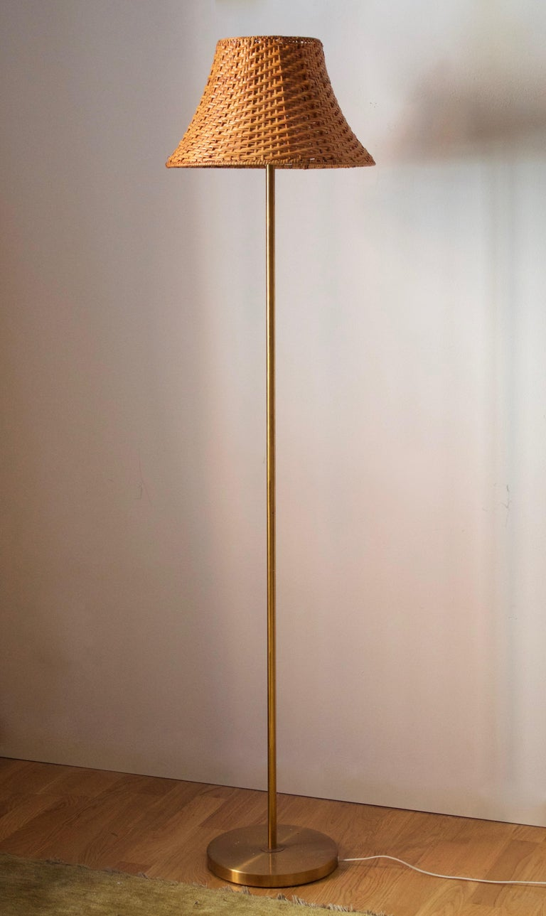 A modernist floor lamp. Produced by Nordiska Kompaniet, 1940s. Stamped.  Other designers of the period include Paavo Tynell, Lisa Johansson-Pape, Carl-Axel Acking, and Gunnar Asplund.