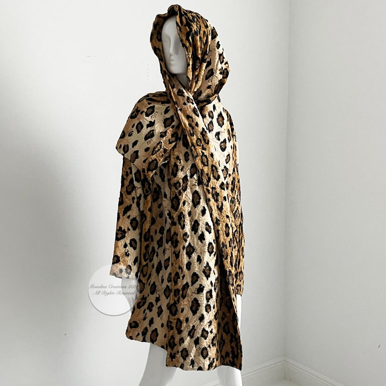 Authentic, preowned, vintage Norma Kamali leopard or tiger print shawl jacket, circa the early 90s. Faux fur leopard or tiger print fabric/fully-lined/dry clean only.  Open jacket with huge shawl collar, it has a slit opening on one side of collar,