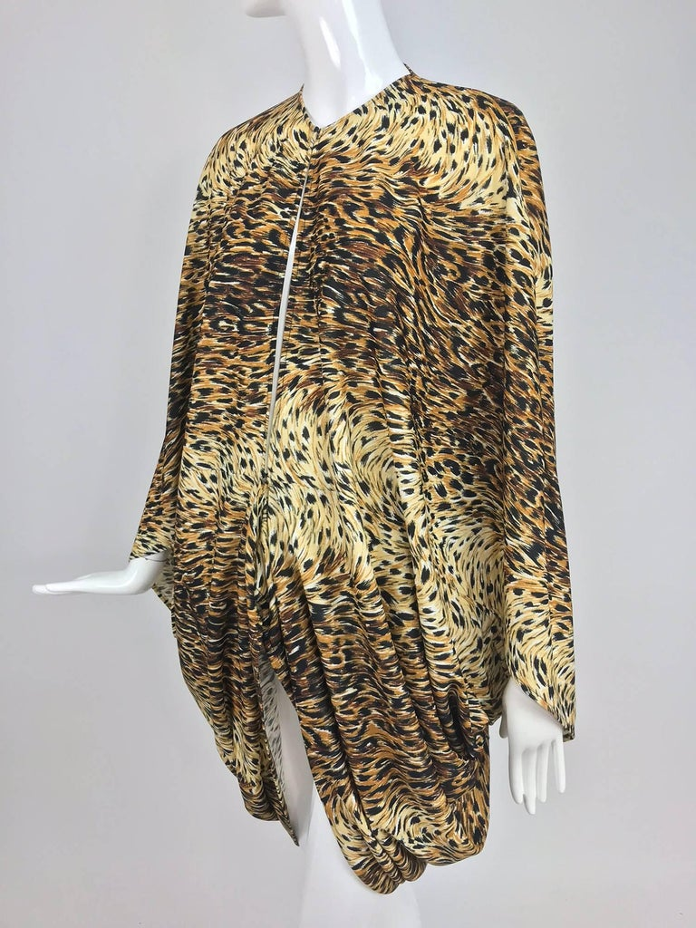 Norma Kamali OMO leopard print cocoon jacket from the 1970s...Unlined nylon/spandex jersey cocoon jacket closes at the front with a hook and eye. Draped shape with arm openings, longer at the back. Fits a size small or medium. In excellent wearable