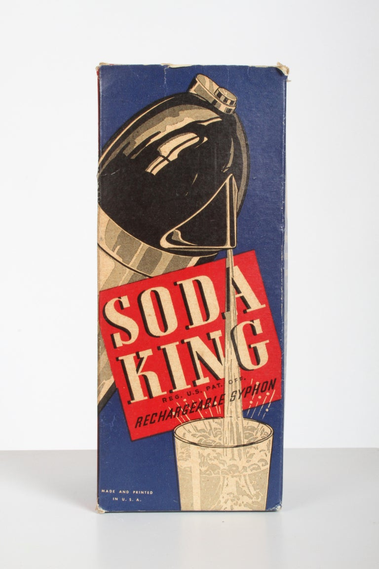 Norman Bel Geddes Soda King rechargeable syphon circa 1938, unused Art Deco / Machine Age / Industrial designer Norman Bel Geddes's chrome plated and enamel Soda King rechargeable syphon, designed in 1938. Belongs in a museum, as it is unused and in