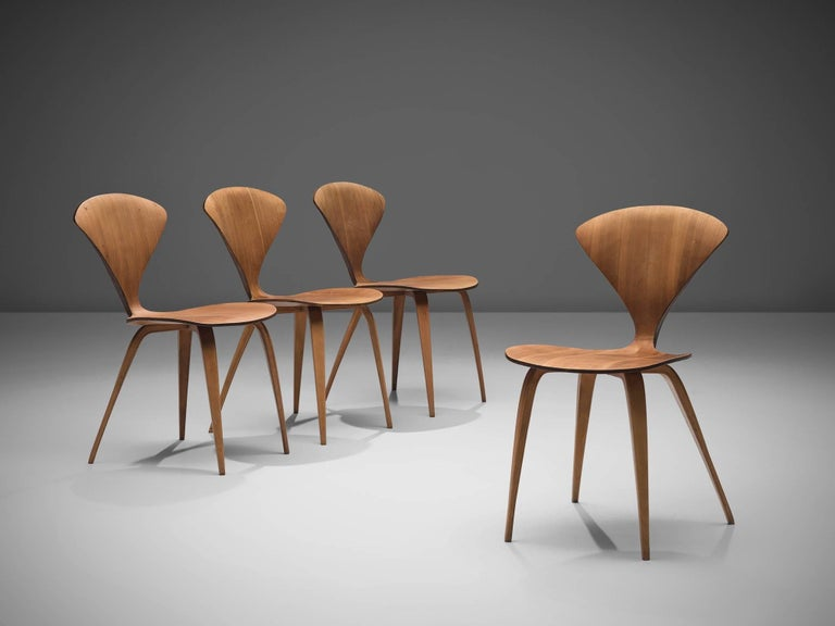 Norman Cherner for Plycraft, set of four dining chairs, walnut and plywood, United States 1957.  These four Classic Norman Cherner plywood chairs date from 1957. Their iconic shape resembles something like a delicate butterfly, yet do not be