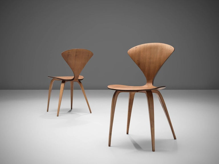 Mid-20th Century Norman Cherner for Plycraft Four Walnut Dining Chairs For Sale