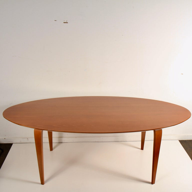 Newly refinished, European beech, molded plywood table by Benjamin Cherner, son of Norman Cherner.  Norman Cherner's sons formed the Cherner Chair Company in 1999 to manufacture and market some of the most recognized designs from their father's