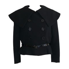 Norman Norell 1960s Black Belted Jacket with Statement Collar