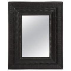 Northern Italian Ripple and Wave Carved and Ebonized Mirror Frame