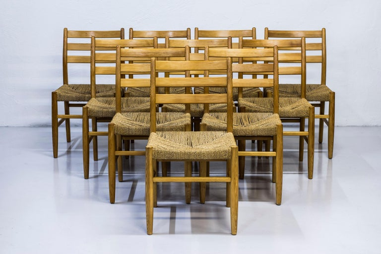 Set of ten dining chairs designed by Harry Moen for Konrad Steinstads Snekkerverksted. Produced in Norway during the 1960s. Made from solid pine with seats of weaved seaweed chord. Very good vintage condition with signs of wear and light