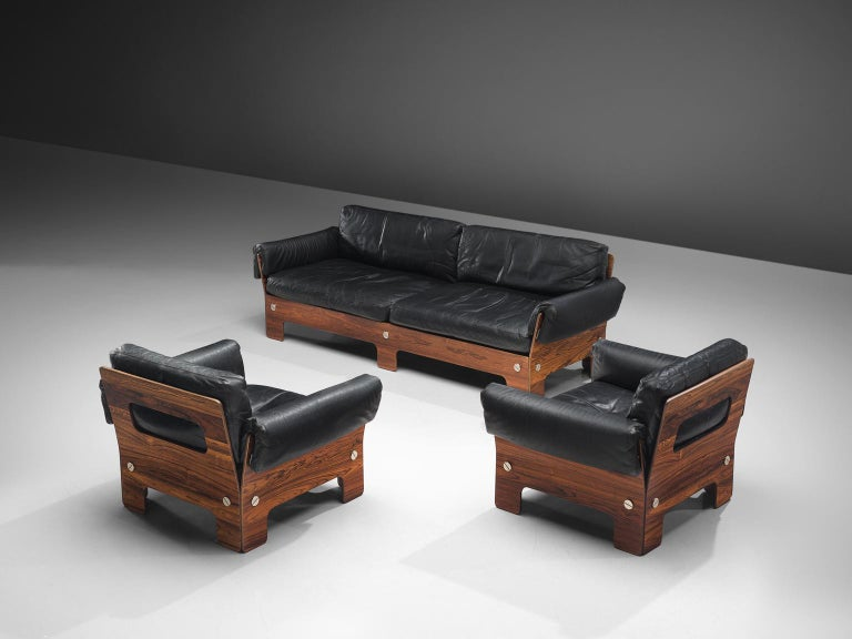 Sofa and chairs, rosewood and black leather, Norway, 1960s. 