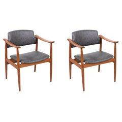 Norwegian Modern Sculpted Teak Arm Chairs