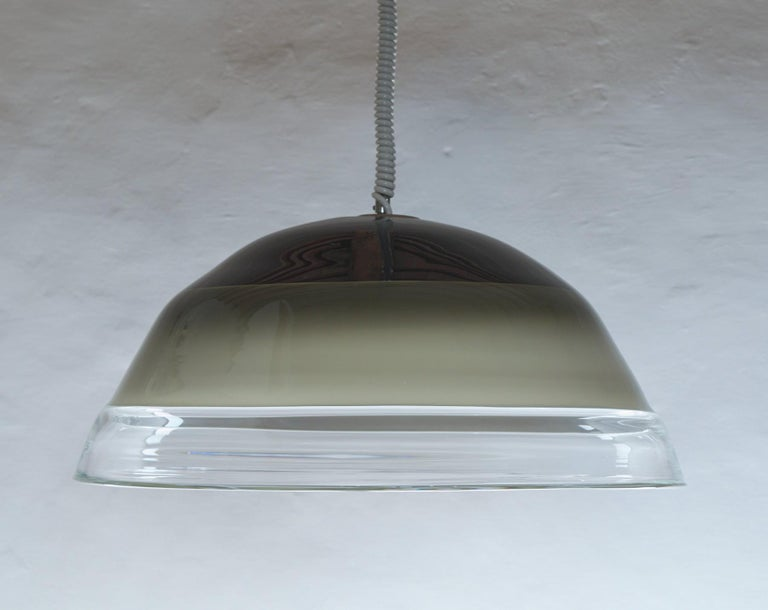 Extraordinary suspension made for Leucos by Toni Massari. Heavy Venetian glass has 3 incalmo. The inner is black outside and white inside, which is a typical design of Renato Toso (Melania) or Toni Massari (Tinta) and Leucos. The white inside