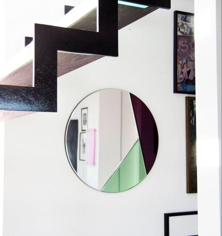 Nouveau design colorful mirror, NOUVEAU 65 Mirror 4mm faceted mirror on black painted MDF Measures: Diameter 70 cm  NOUVEAU 65 The Nouveau round mirror series unites elegance with simplicity and is characterized by its geometric color