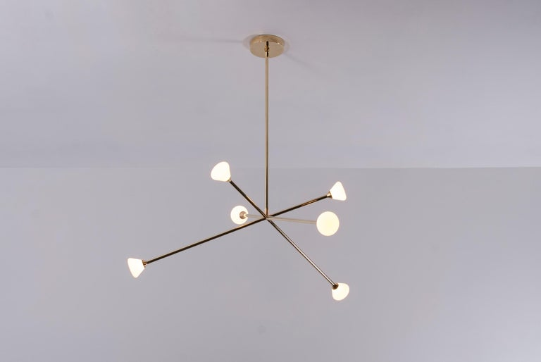 The Nova chandelier is centerpiece fixture with an elegant and energetic composition. This contemporary chandelier branches out from a central point in a pure, geometric manner. It features six white glass shades that house powerful, dimmable LED's.