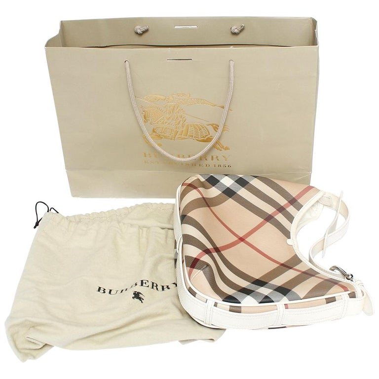 0574c6eb58 This chic hobo is crafted of classic Burberry Nova check canvas. The bag  features a