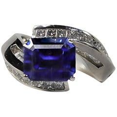 Nova Emerald Cut Sapphire, Baguette and Princess Cut Diamond By-Pass Ring